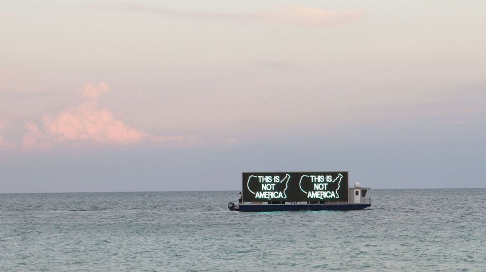 Alfredo Jaar's A Logo for America will sail up and down the Miami Beach shoreline for eight hours a day