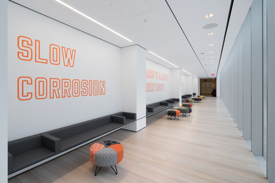 The Museum of Modern Art's expansion project includes the Louise Reinhardt Smith Gallery, which features a wall work by Lawrence Weiner