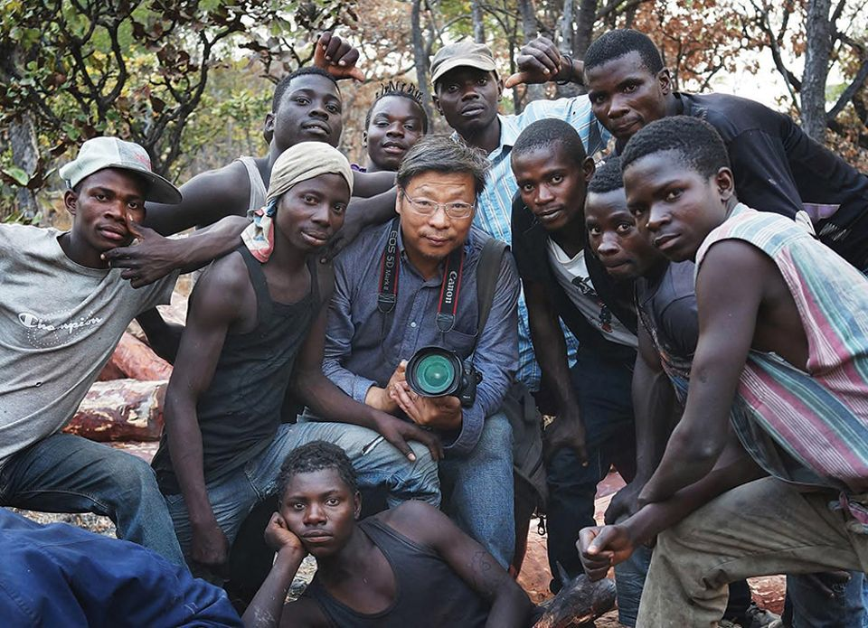 Lu Guang with loggers, August 2016, Democratic Republic of Congo