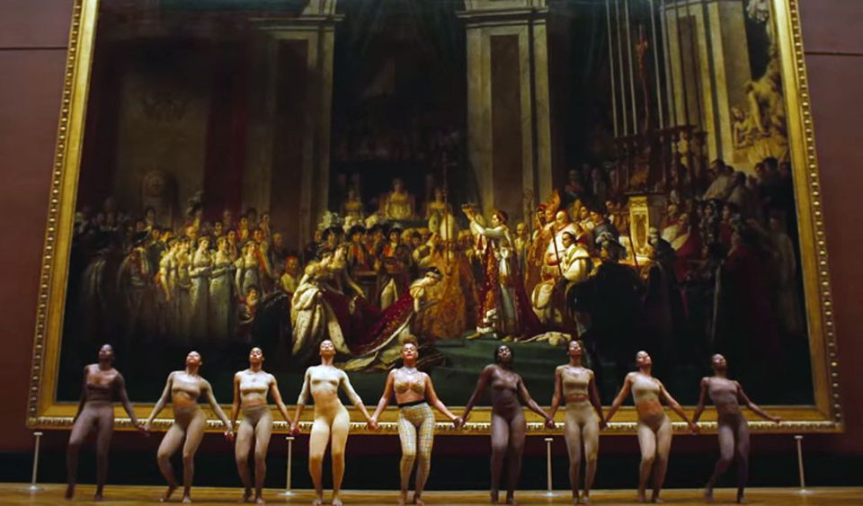 Beyoncé and dancers in front of The Coronation of Napoleon I and the Crowning of the Empress Josephine at the Louvre museum in Paris