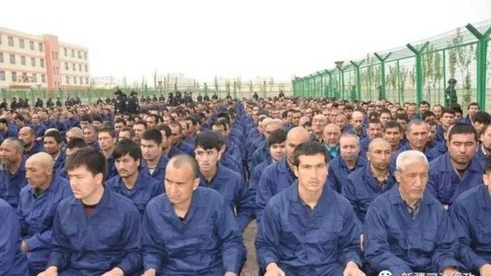 A photo posted to the WeChat account of the Xinjiang Judicial Administration shows Uyghur detainees at a re-education camp in April 2017.