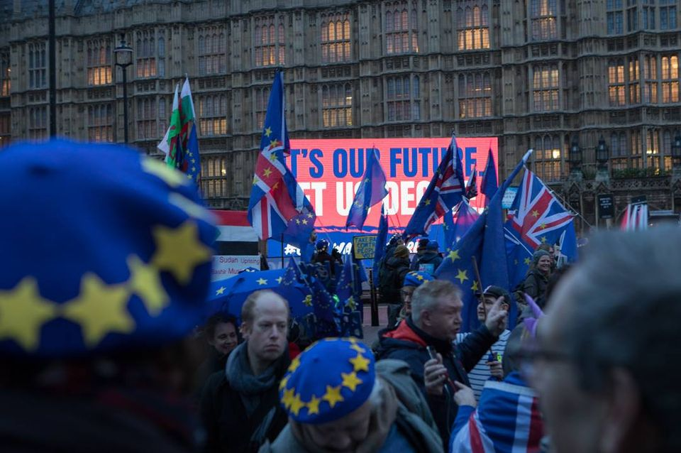Protestors gathered both in support and against Brexit outside the House of Parliament in London last night (15 January)