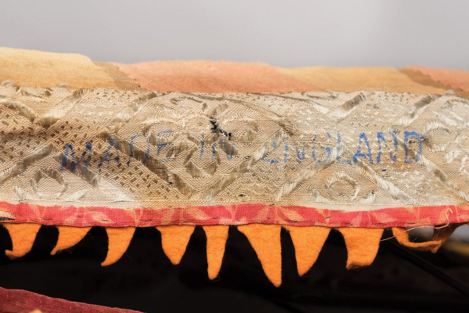 Detail of a strip of fabric made in England that is part of the egungun costume at the Brooklyn Museum