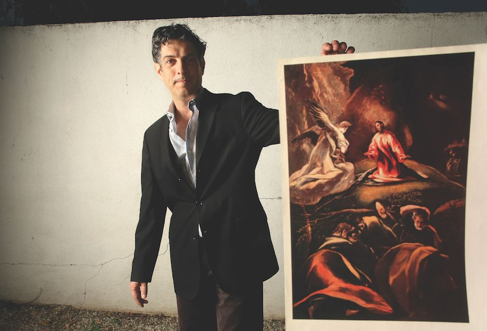 David de Csepel, the great grandson of Baron Herzog, with a photocopy of The Agony in the Garden by El Greco, formerly part of Baron Herzog's art collection