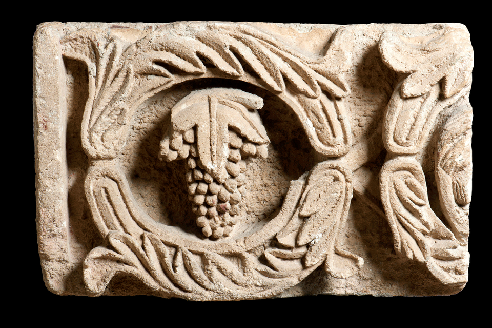 Vine scroll frieze fragment from Period III Altar platform at Khirbet et-Tannur