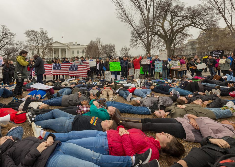"""High school students from across the Washington, DC area hold a """"die-in"""" in front of the White House to protest gun control laws. Washington, D.C. February 19, 2018"""