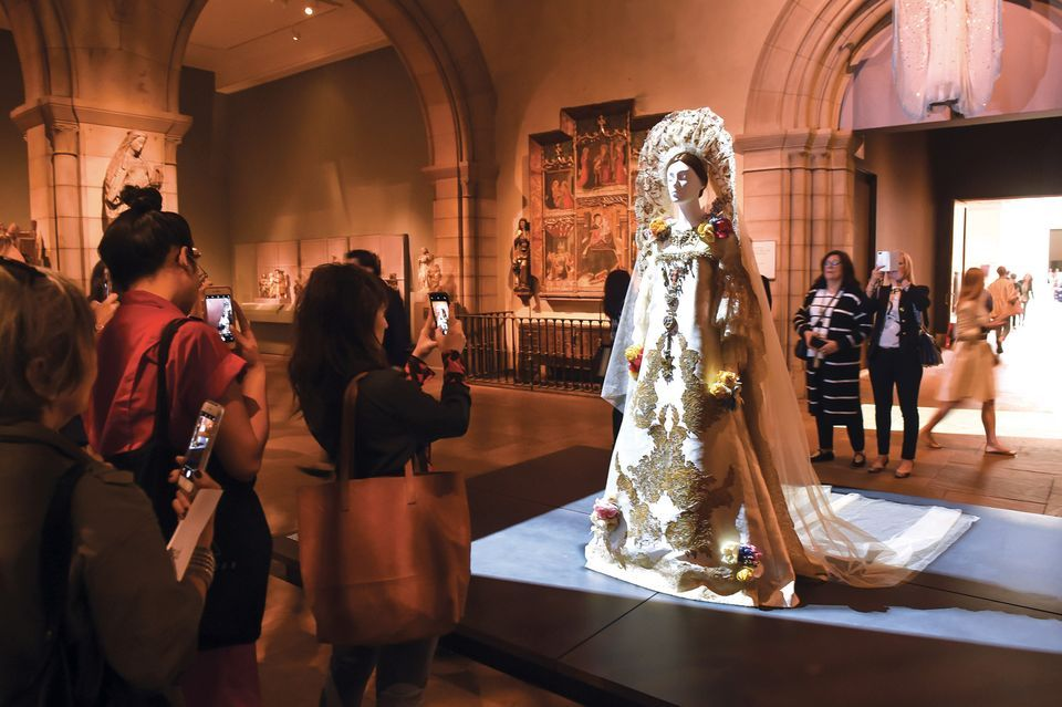 Visitors at the Met's record-setting Heavenly Bodies show