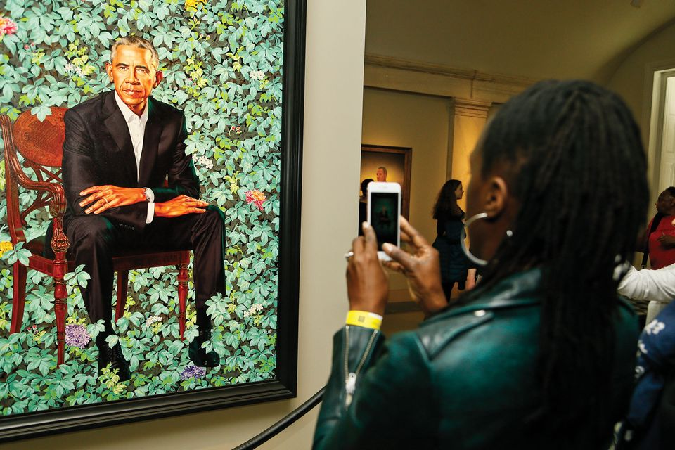 A visitor snaps Kehinde Wiley's portrait of Barack Obama at the National Portrait Gallery in Washington, DC