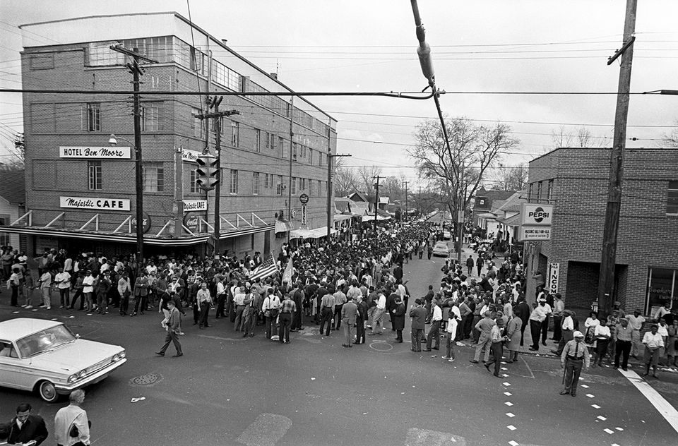 Marchers gathering outside the Ben Moore Hotel in Montgomery, Alabama
