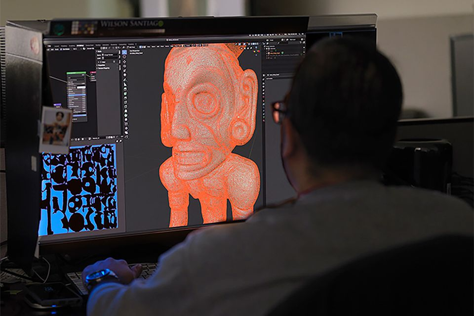 The Metropolitan Museum of Art's imaging production manager Wilson Santiago works on an AR model of the zemí cohoba stand